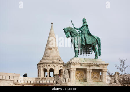 BUDAPEST, HUNGARY - FEBRUARY 02: Bronze statue of Saint Stephen, in the Old Town district, with Fisherman's Bastion - Stock Photo