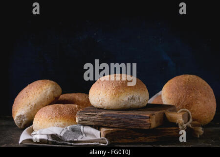 Fresh baked wholegrain buns - Stock Photo
