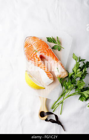 raw salmon steak on cutting board, food top - Stock Photo