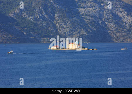 Our Lady of the Rocks church (1632) and islet (1452) in the Bay of Kotor in Montenegro - Stock Photo