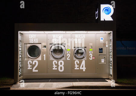 Revolution 24/7 outdoor self-service launderette laundry / launderette in grounds / forecourt of Esso petrol station, - Stock Photo