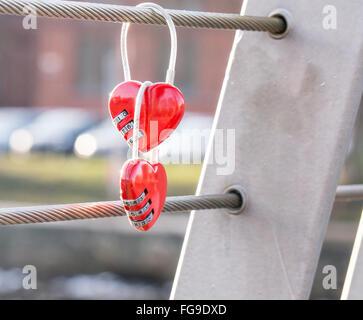 Close-Up Of Combination Locks Hanging On Railing - Stock Photo