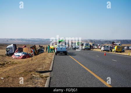 Accident scene along the highway involving many vehicles - Stock Photo