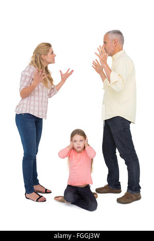 Parents arguing beside their upset daughter - Stock Photo