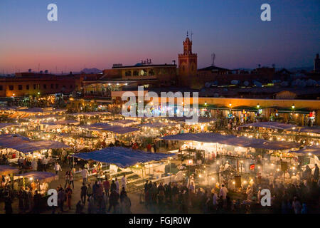 Evening cafes and stalls in Jemaa El Fna Square. Marrakech, Morocco - Stock Photo