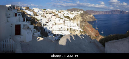 SANTORINI, GREECE - OCTOBER 4, 2015: The look from Oia to east in evening light. - Stock Photo