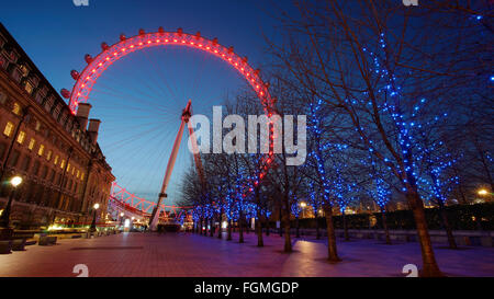 London - February 16, 2016: Night view of London Eye. A famous tourist attraction, 135 meters, biggest Ferris wheel - Stock Photo