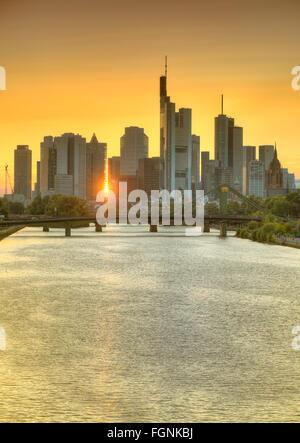Skyline and financial district at sunset, twilight, TaunusTurm, Tower 185, Commerzbank, Messeturm, Helaba Landesbank - Stock Photo