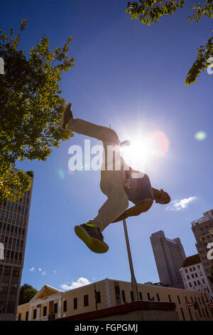 Man doing parkour in the city - Stock Photo