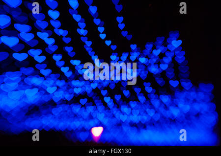 beautiful bokeh made of warm blue blurred lights in the form of hearts - Stock Photo