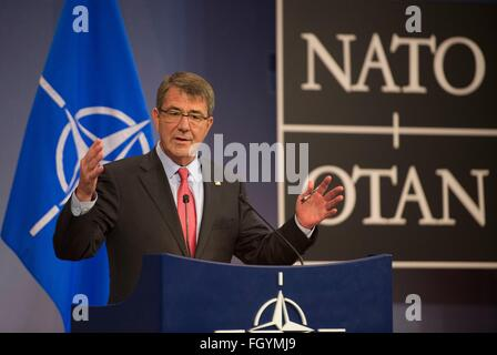 U.S Secretary of Defense Ashton Carter speaks with reporters during a press conference at NATO headquarters February - Stock Photo