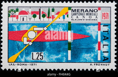 1971 - Italian mint stamp issued to commemorate World  canoe championship. Lire 25 - Stock Photo