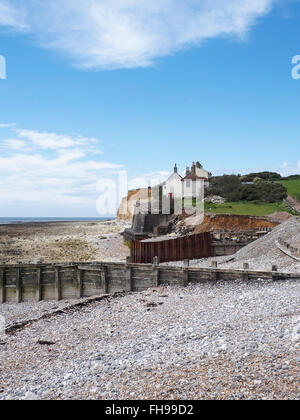 Cuckmere Haven coast guard cottages on the Sussex Coast under threat from coastal erosion - Stock Photo