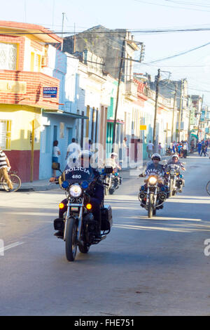 Santa Clara, Cuba, February 24, 2016: Cuban police clearing the streets to the entrance of cyclists for the event - Stock Photo