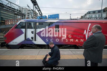 Kings Cross Station, London, UK. 25th February, 2016. Virgin Trains modern day Flying Scotsman liveried Class 91 - Stock Photo