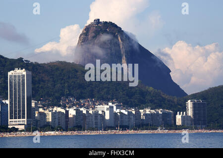 Copacabana Beach with Sugar Loaf in the background - Stock Photo