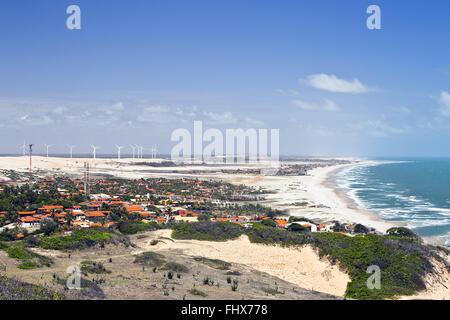 Morro Branco beach with wind turbines Central Eólica Beberibe left - Stock Photo