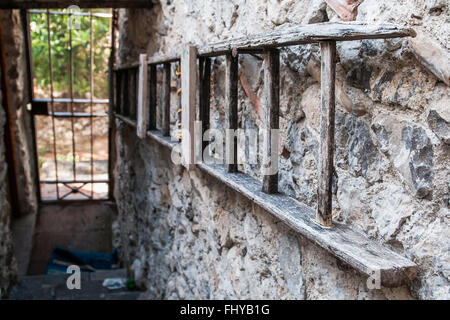 Ladder to the gate with scale and garden - Stock Photo