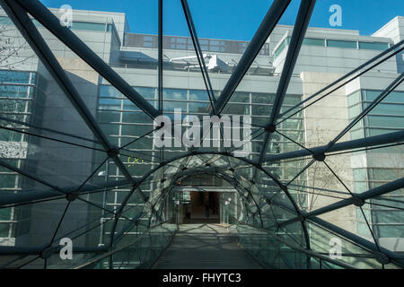 The Web of Consumerism, the bride between the Arndale Centre and Selfridges department Store in Manchester - Stock Photo