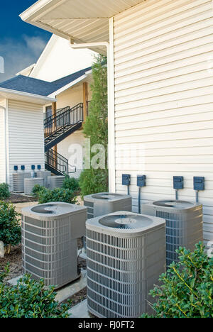 Air Conditioning Units For Multi-Family Apartment Building Vertical - Stock Photo