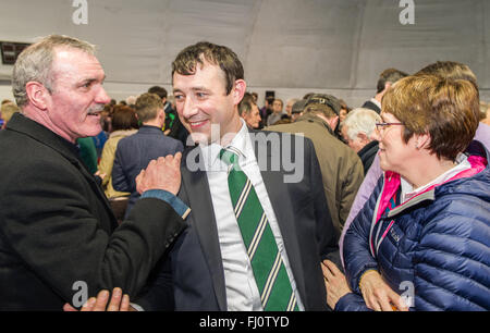 Ballincollig, Ireland. 27th February, 2016. Fianna Fáil Candidate Aindrias Moynihan celebrates with colleagues and - Stock Photo