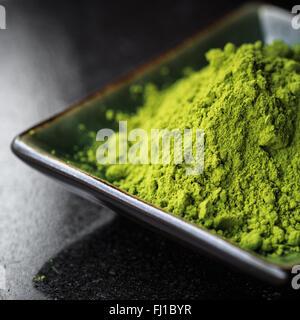 Matcha tea in a bowl - Stock Photo