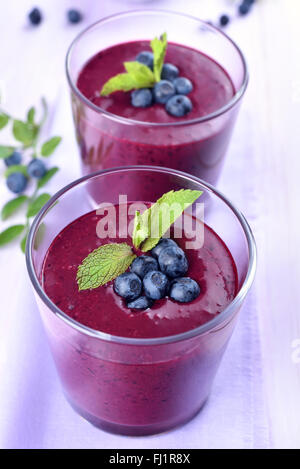 Blueberry juice smoothie in glass - Stock Photo