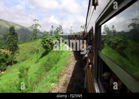 On the road on a train in green Sri Lanka in the middle of the island - Stock Photo
