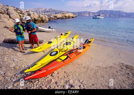 three sea kayaks in a bay, France, Provence, Calanques National Park, La Ciotat - Stock Photo