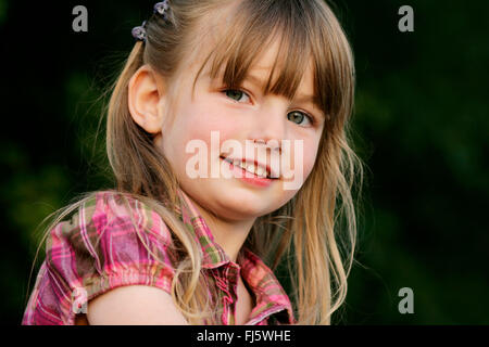 little girl smiling, portrait, Germany - Stock Photo