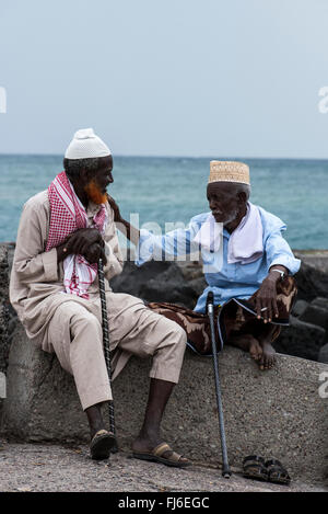 Old men chatting by the pier in Tadjoura, Djibouti, Africa - Stock Photo