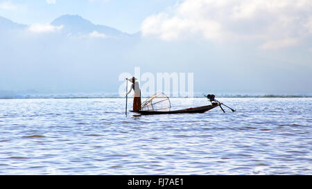 Silhouette of fisherman at sunset Inle Lake Burma Myanmar - Stock Photo