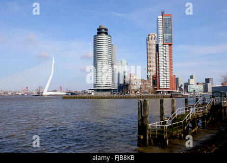 Skyline of Rotterdam, Netherlands. Erasmus bridge, World Port Center, Hotel New York, Montevideo tower on Kop van - Stock Photo