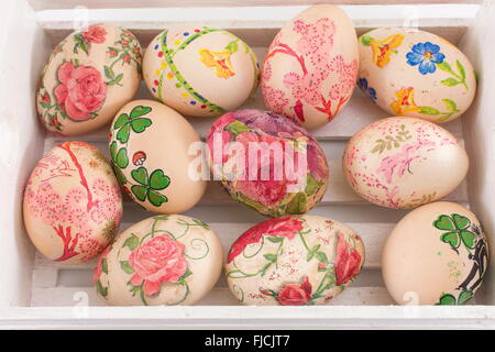 Decoupage decorated Easter eggs in a wooden box - Stock Photo