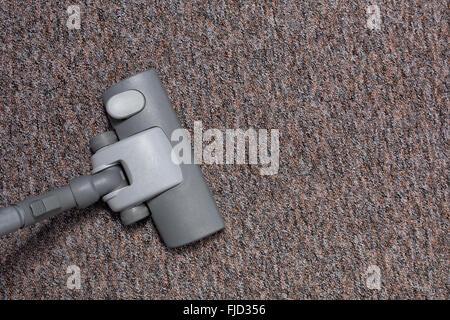 vacuuming carpet at home - Stock Photo