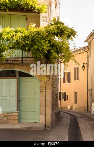 Old stone buildings line a narrow street in the typical historic village of Vinsobres, Cotes du Rhone, Provence, - Stock Photo