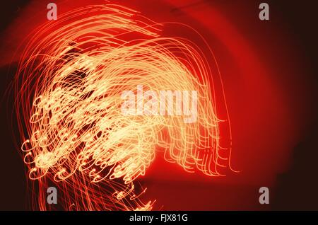 Abstract Image Of Illuminated Light Trails During Christmas - Stock Photo