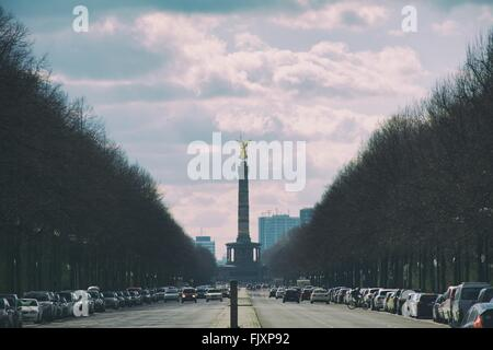Road Leading Towards Berlin Victory Column In City Against Sky - Stock Photo
