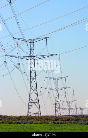 High voltage electricity pylon line - Stock Photo