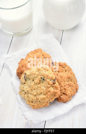 Cereal oats cookies and yogurt on white wooden table - Stock Photo