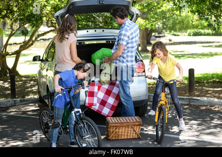 Family in front of a car - Stock Photo