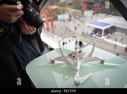 (160305) -- SHENZHEN, March 5, 2016 (Xinhua) -- A photographer takes pictures of a Phantom 4 drone developed by - Stock Photo