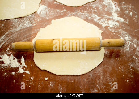 dough pizza pin rolling cooking food white table flour - Stock Photo