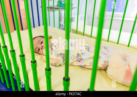 Sofia, Bulgaria - March 1, 2016: An young baby boy with a cardiac disease is lying in a bed in a cardilogical children's - Stock Photo