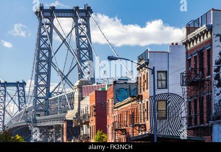 Brooklyn street scene with block of buildings near the Williamsburg Bridge in New York City - Stock Photo