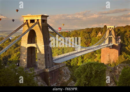 Clifton Suspension Bridge, with hot air balloons in the Bristol Balloon Fiesta in August, Clifton, Bristol, England - Stock Photo