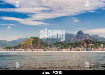 Cityscape and Copacabana beach in Rio de Janeiro, Brazil - View from the water - Stock Photo