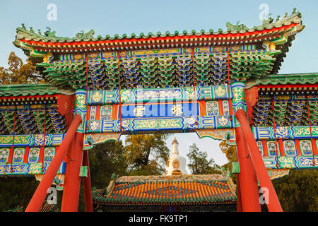 entrance gate to the White Tower on Jade Flower Island, Round City, or City of Harmony, in Beihai Park, Beijing, - Stock Photo