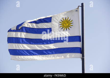 Argentine flag hoisted in front of the Tourism Department in Praia do Forte - Stock Photo