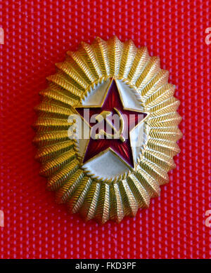 A popular badge of the Soviet Union shows a red star with the hammer and sickle, a Communist symbol created for - Stock Photo
